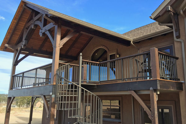 Black-Forest-Timber-Frame-Home-Colorado-Canadian-Timberframes-Covered-Deck