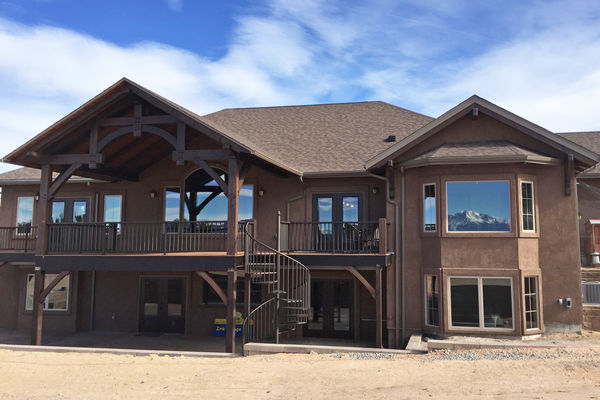 Black-Forest-Timber-Frame-Home-Colorado-Canadian-Timberframes-Rear-Exterior