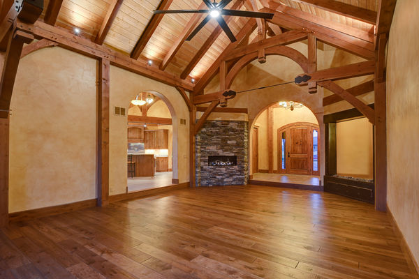 Colorado-Springs-Timber-Home-Canadian-Timberframes-Great-Room-Fireplace
